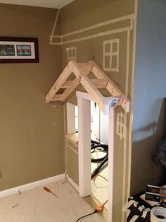 use tape to outline house before cutting the wall. How cute is this?!