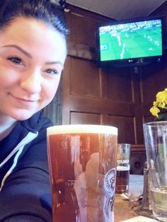 Watching the rugby with her beer <3