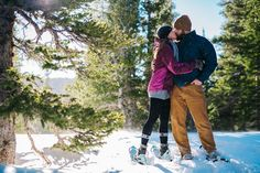 St. Mary's Glacier snowshoeing engagement shoot. Showshoe Engagement Photos by Maddie Mae Photography