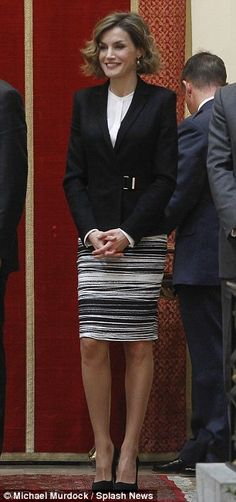 Queen Letizia teamed her skirt with a white blouse and tailored black blazer as she presented awards at the Justice and Disability Forum awards in Madrid, Spain Dec 2015
