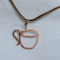 Sparkflightstudio Hammered Copper Coffee Cup Pendant  This would be so easy to make.  I might take a coffee bean and hang it below though