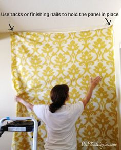 Putting fabric on the wall with starch.  Comes off easily with no damage.  Like wallpaper.