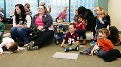 Almost everybody looks happy to be at storytime...