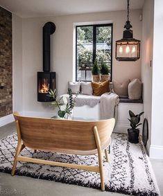 10 Beautiful Rooms The natural tones and stripped-back chair in this Scandinavian-inspired room are built around a picturesque window view surrounded by classic log-burner and retro lighting. This would be the perfect living room of comfort in every home. Living Room With Fireplace, Living Room Decor, Small Fireplace, Fireplace Ideas, Living Rooms, Stove Fireplace, Living Room Wall Lighting, Log Burner Living Room, Wall Mounted Fireplace