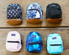 Small and light, the JanSport Half Pint is the perfect throw-on-and-go minature backpack! Features include a front utility pocket and key clip, check it out now!
