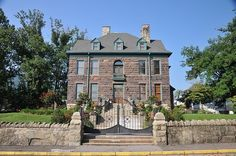 """A National Historic Landmark, the Southwest Virginia Museum is in an 1890s Victorian stone mansion with original oak interior. The museum's collection includes more than 25,000 pieces and state of the art exhibits telling the story of the exploration and development of Southwest Virginia from the pioneer era of the 1700s to the mining """"boom and bust"""" era of the late 1800s. #LoveVa #LoveHOA #History #Museum Big Stone Gap, Stone Mansion, Much Music, Museum Collection, History Museum, State Art, Genealogy, Virginia, Places To Visit"""