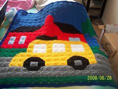 wheels-on-the-bus  Free crochet afghan quilt design which is made up of small granny square blocks