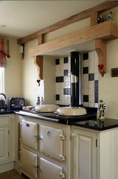 cottage kitchen with traditional Aga stove