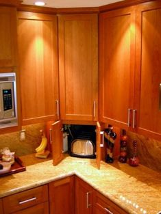 Hide your small appliances by building a little storage nook in the corner of your countertop.