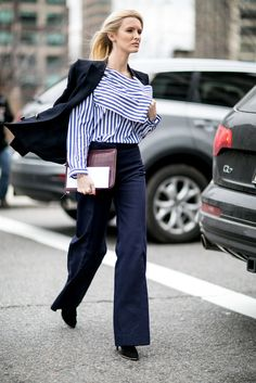 Wide-leg pants paired with a shirt and a blazer.