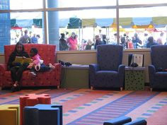 In addition to the tiny chairs in the magazine rack shot, Imaginon also has couches for parents/caregivers to sit and share stories. The puzzle piece ottomans were also very popular.
