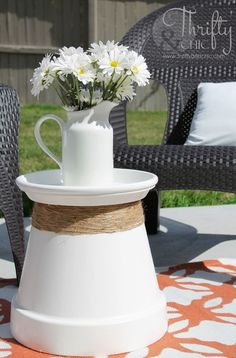 Flip a planter over and place the saucer on top to create a place to set a drink or display a vase on your patio. Get the tutorial at Thrifty & Chic »  - GoodHousekeeping.com