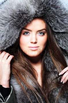 Beautiful girl wearing winter fur coat'