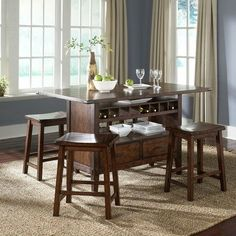 Cabin Fever Formal 5 Piece Center Island Dining Set in Bistro Brown by Liberty. $1088.66. 121-IT3660T / 121-IT3660B / 121-B0000024   Features: -Set includes center island dining table and 4 barstools. -Cabin Fever Formal Dining collection. -Bistro Brown finish. -Oak planked tops. -Wine bottle storage. -Pewter knob and pull hardware. -Tapered block legs. -Nylon chair glides. -Assembly required. -Manufacturer provides one year limited warranty.