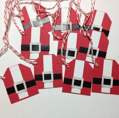 handmade Santa suit Christmas gift tags w/ bakers twine set of 10. $5.00, via Etsy.