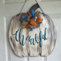 Fall colors Fall Crafts, Halloween Crafts, Holiday Crafts, Wood Crafts, Diy Crafts, Pumpkin Door Hanger, Fall Door Hangers, Wooden Pumpkins, Wooden Cutouts