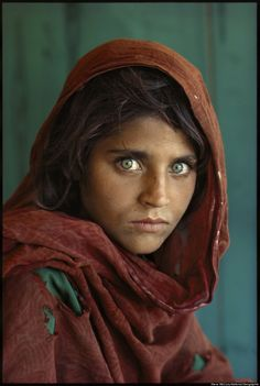 Steve McCurry's iconic photograph of a young Afghan girl in a Pakistan refugee camp - Nat Geo June 1985