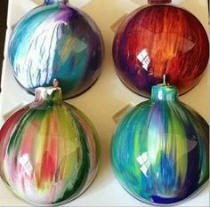 ..take clear bulbs and put a couple drops of acrylic paint and shake... pretty...