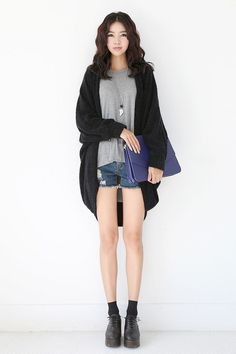 Wear a black open cardigan with blue denim shorts for an effortless kind of elegance. Elevate this ensemble with black chunky leather oxford shoes.   Shop this look on Lookastic: https://lookastic.com/women/looks/open-cardigan-crew-neck-t-shirt-shorts/18318   — Black Open Cardigan  — Silver Pendant  — Blue Leather Clutch  — Grey Crew-neck T-shirt  — Blue Denim Shorts  — Black Socks  — Black Chunky Leather Oxford Shoes