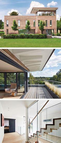 Stadtvilla modern mit Flachdach Architektur, Holz Fassade & Dachterrasse - Fertighaus bauen Ideen Design Haus Weald House von Baufritz - HausbauDirekt.de