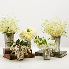New Year's Eve Winter White Arrangement: Place the displays on surfaces with varying heights for an added element of interest.