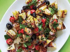 Grilled Yukon gold potato halves combine with a mixture of tomatoes, capers, oregano, olives, and anchovies for a Mediterranean-style potato salad side dish.
