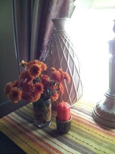 Add pieces like irish connemara china and clear votives with fall colored stone with my mum cuttings from my garden