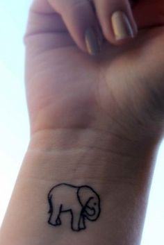 small tattoo - elephant   I really want this on like my ankle. Elephants are smart animals who's memories go back decades. They aare strong and always Preserver. I love it