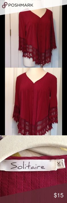 Pretty garnet/burgundy blouse with lace This blouse is burgundy more then red. Very pretty. In perfect condition. Very boho chic. Only worn once. Lace detail on the bottom and arms. Purchased at a boutique. Solitare Tops Blouses