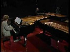 """Pianists Cees Van Zeeland, Gerard Bouwhuis, Arielle Vernede and Gene Carl are performing the final minutes of Simeon Ten Holt's """"Canto Ostinato for 4 Pianos""""."""