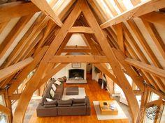 Living Room Exposed Oak Cruck Cross Frame Detail by Carpenter Oak