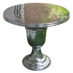 Polished aluminum pedestal table with a turned base.Product: TableConstruction Material: AluminumColor: