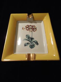 Vintage Limoges Tray with botanical design. Gorgeous Limoges ashtray, bright yellow and gold edges surround a beautiful flower in the center