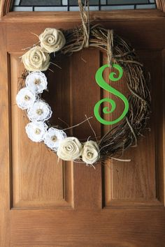 "Here is a perfect wreath for the season! This is an 18"" Grapevine Wreath with burlap rosettes and lace flowers. You can have a custom letter and color. Make this a unique Christmas wreath with a green or red letter!"