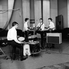 The Beatles during an early recording session at Abbey Road by Dezider Hoffmann on 6th June 1962