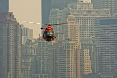 A private helicopter landing with the New York City skyline in the background. Stratos Jets is a premier jet and helicopter charter service. To charter an aircraft, call one of our helpful associates at (888) 594-7141.