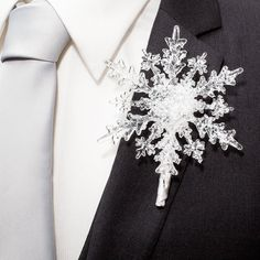 Its a snowflake!! This is a GREAT boutonniere, super fun and classy! Its made of a frosted 4.4 acrylic snowflake, and has a satin stem for pinning. Completion Time : This boutonniere is made to order, and has a completion time of 2-3 weeks. If you need something sooner, please send a message before ordering to see if your time frame can be accommodated.  Shipping : Once complete, the boutonniere ships Priority Mail in the US, and First Class to Canada and Everywhere else.  Matching wrist…