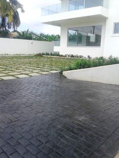 Entrada a casa particular con pavimento de hormig n for Adoquin para estacionamiento