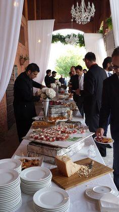 Buffet di aperitivo prima della cena. Catering: Giemme Ricevimenti. Portico barchessa, Corte Dei Paduli, Reggio E., Italy.