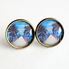 Handmade earrings with beach pier images under epoxy.