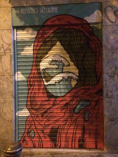 Refugee - painted shutter - Madrid
