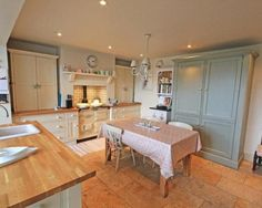 Lovely feel to this kitchen. The housekeepers cupboard is very appealing and yet practical