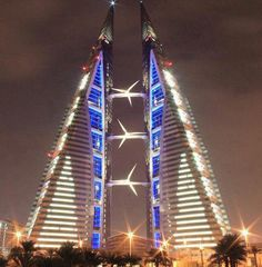 IThe Bahrain World Trade Center.It is the first skyscraper to have wind turbines integrated into the structure of the building. Three large wind turbines are suspended between two office towers. The towers are aerodynamically tapered to funnel wind and draw air into the turbines.