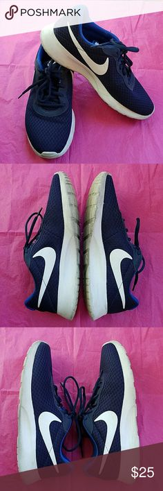 Nike Tanjun Running Shoes In GUC, wore these a few times. These are a Men's size 8.5/Women's size 10.5, I wear a size 10 and had no problems with these. I will scrub & wash these by hand, wash & sanitize the insoles, they will be spotless before shipping, Color: Midnight Navy/White/Game Royal, MSRP $65.00 Nike Shoes Sneakers