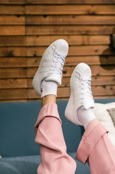 White sneakers that transition from season to season. Shop adidas originals Superstar shoes. #whitesneakers