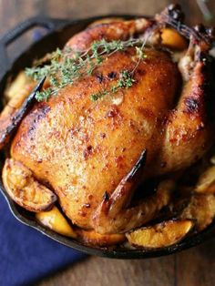 Orange Thyme Roasted Chicken - A whole chicken roasted in a cast iron pan on a bed of oranges, onion and fresh thyme. Maybe the best chicken you've ever had Cast Iron Roasted Chicken, Whole Roasted Chicken, Stuffed Whole Chicken, Roast Chicken, Grilled Roast, Cast Iron Recipes, Incredible Recipes, Dinner Entrees, Yum Yum Chicken