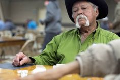 Best mustache of the month: Charlie Hernandez Jr., 76, of Goliad, competes Sunday in the Texas State Championship Domino Tournament. Hernandez Jr. became a Texas Domino Hall of Fame Inductee on Sunday. Hernandez Jr. played in the domino halls of Goliad growing up, often wagering who would have to buy the next beer.