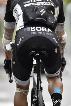 Poland's Rafal Majka injured after falling crosses the finish line at the end of the 1815 km ninth stage of the 104th edition of the Tour de France...
