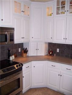Upper Corner Kitchen Cabinet Ideas | Corner cabinets - upper, lower, and appliance garage - doors closed #homeimprovementkitchencabinets