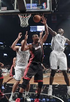 #NBApreseason Miami Heat's Chris Bosh (1) fights for control of the ball with Brooklyn Nets' Kevin Garnett (2) and Brook Lopez (11) during the first half of an NBA basketball game Thursday, Oct. 17, 2013 in New York. (AP Photo/Frank Franklin II)